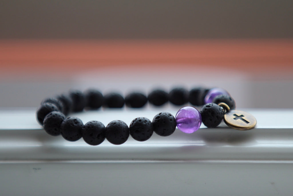 I am guided bracelet in Lava & Amethyst with brass crusifix charm