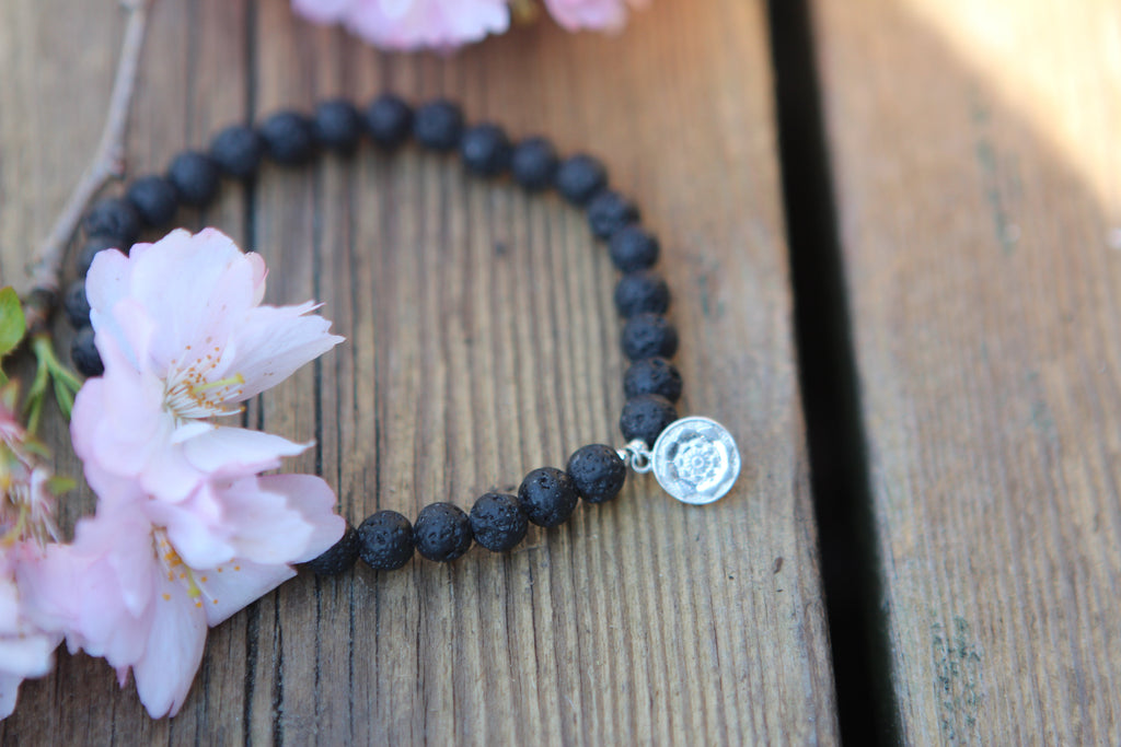 Lava bead diffuser bracelet with silver charm Lotus Mandala