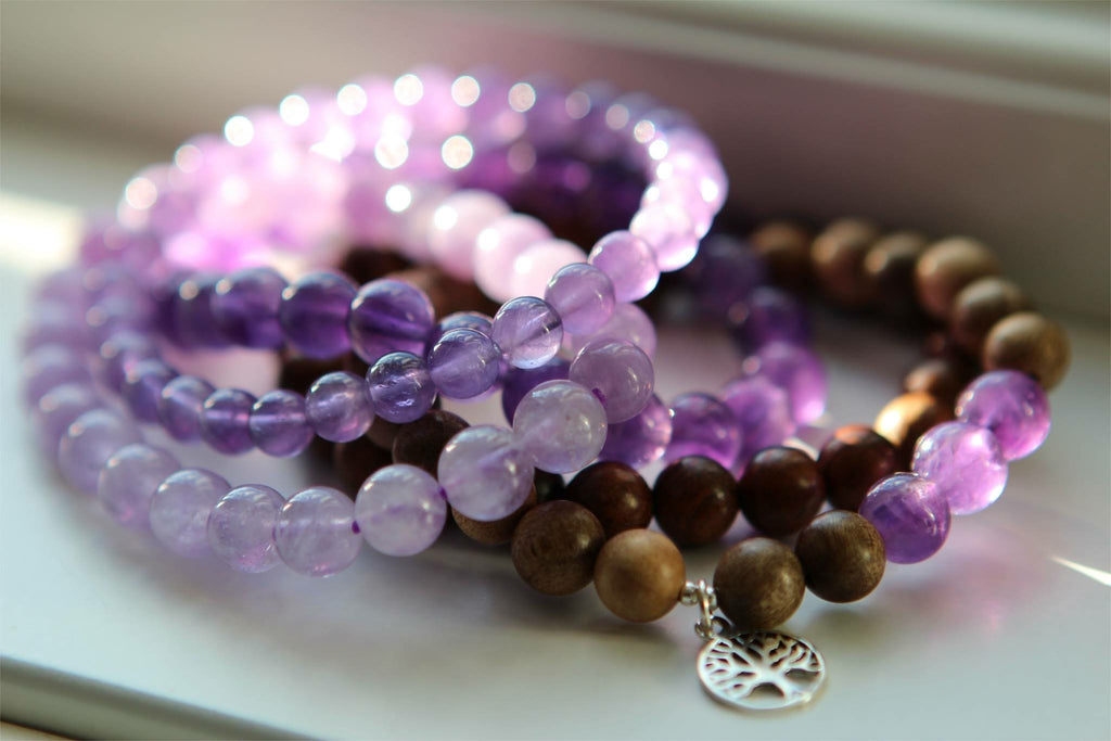 INTUITION Bracelet in light wood and Amethyst with silver charm Lotusmandala