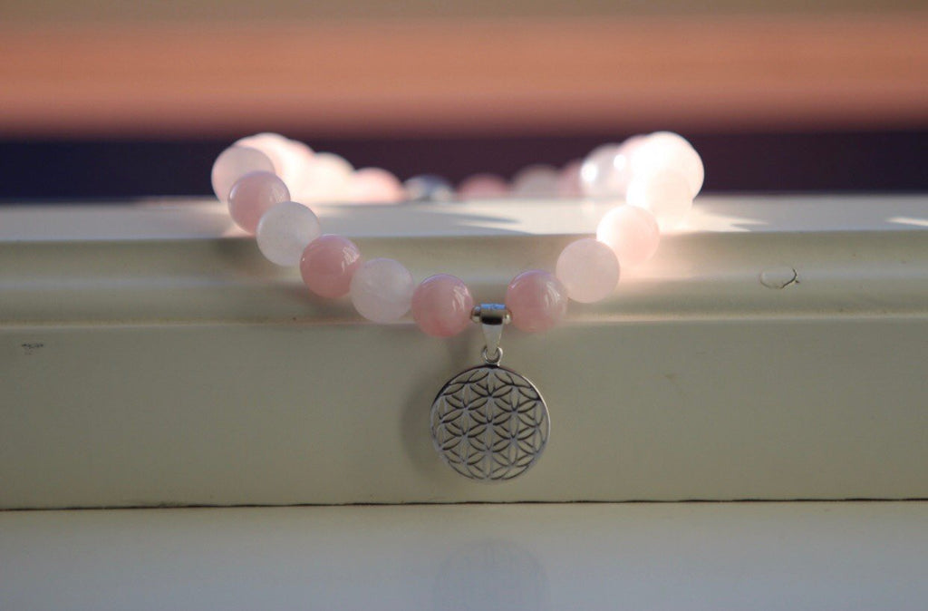 Mala bracelet in Rose Quartz with a silver bead and charm Flower of life