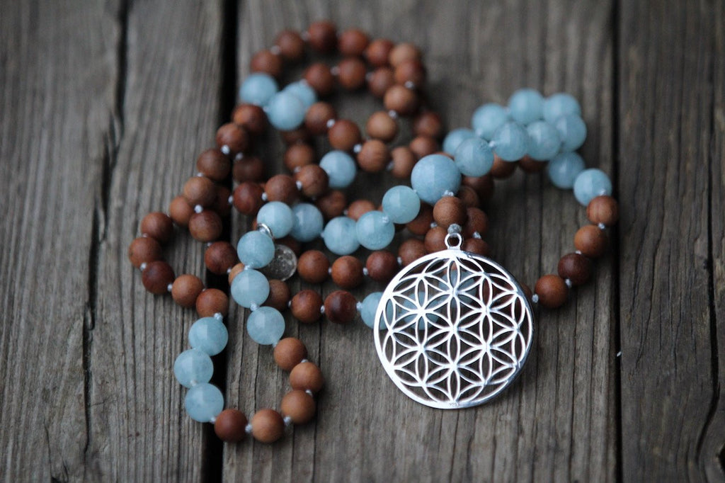 GAYATRI Mala in Sandalwood and Aquamarine with silver charm Flower of life and Lotus Mandala