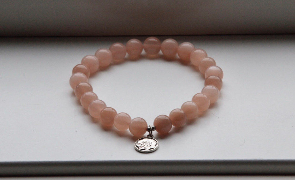 Mala bracelet NEW BEGINNINGS in Peach Moonstone with silver charm Lotusmandala (7 mm beads)