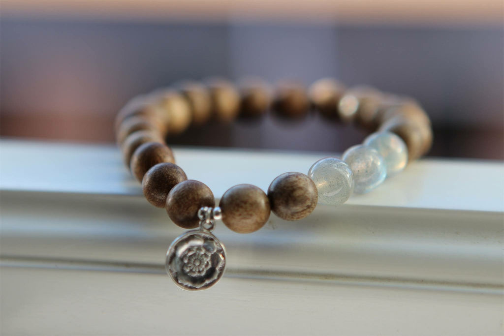 TRANSFORMATION Bracelet in light Wood and Labradorite with silver charm Lotusmandala