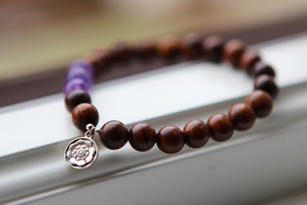 INTUITION Bracelet in dark Wood and Amethyst with silver charm Lotus Mandala