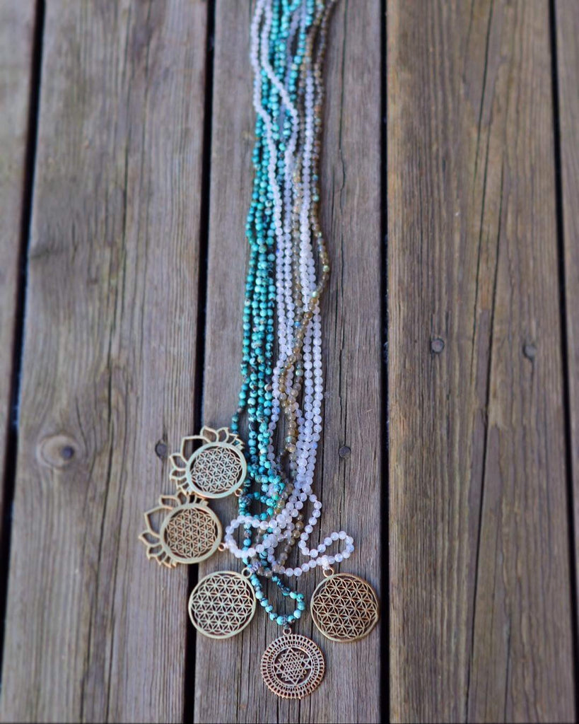 Truly GRATEFUL Mala in 216 Turquoise beads with brass pendant Flower of Life