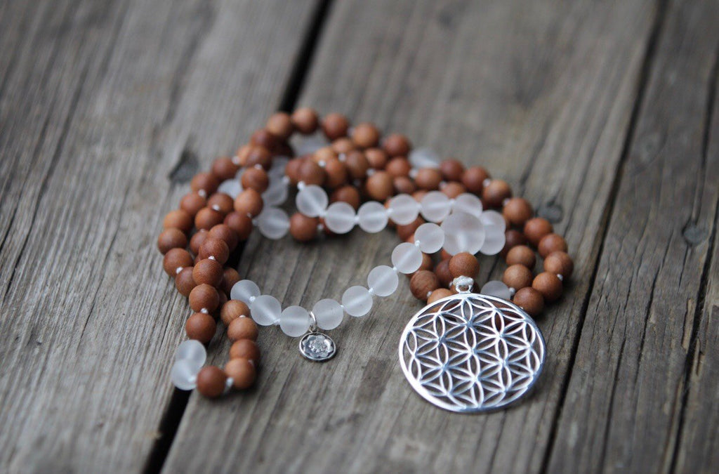 GAYATRI MALA in Quartz (Matt) and Sandalwood with Flower of Life pendant