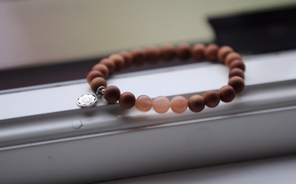 NEW BEGINNINGS bracelet in Sandal wood & Peach moonstone with silvercharm Lotusmandala