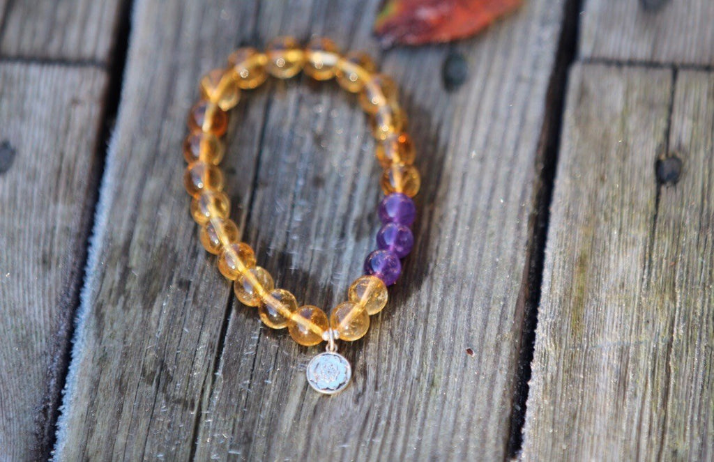 Bracelet in Citrine and Amethyst with silver charm Lotus Mandala