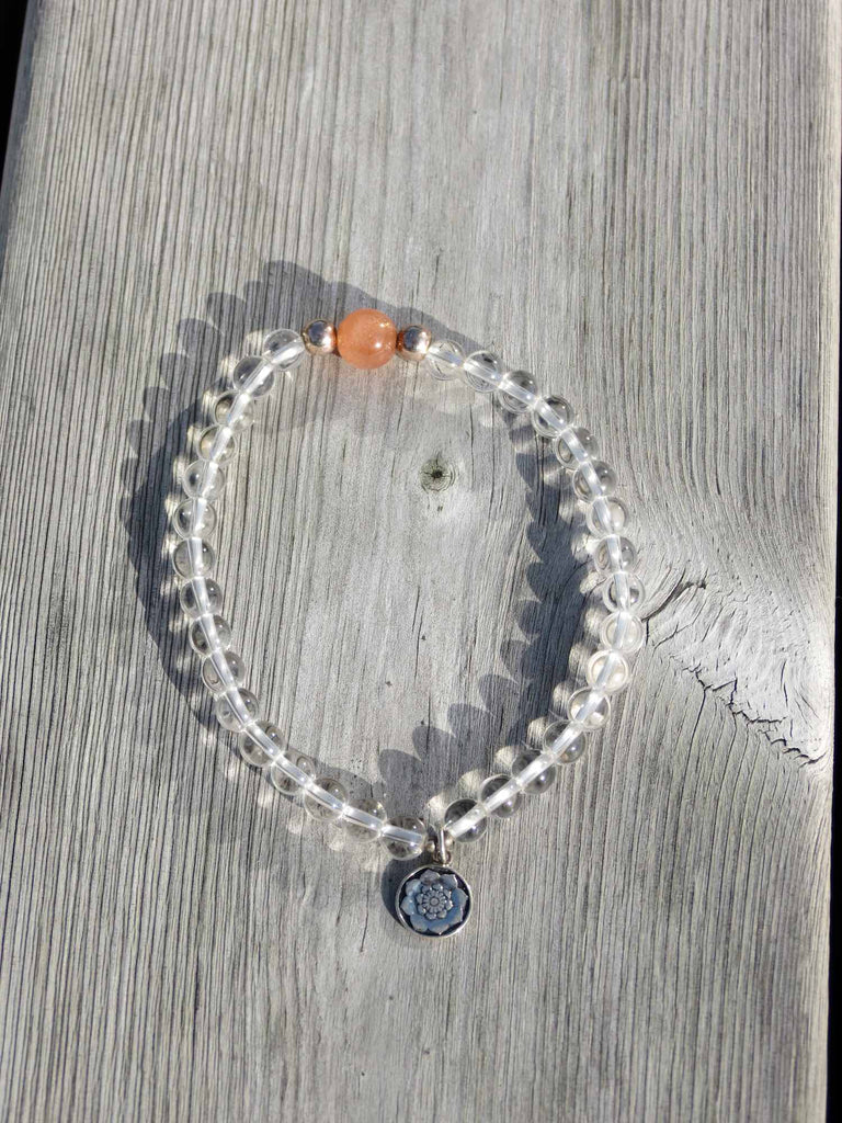 Bracelet in Peach Moonstone and Clear Quartz with silver charm Lotus Mandala