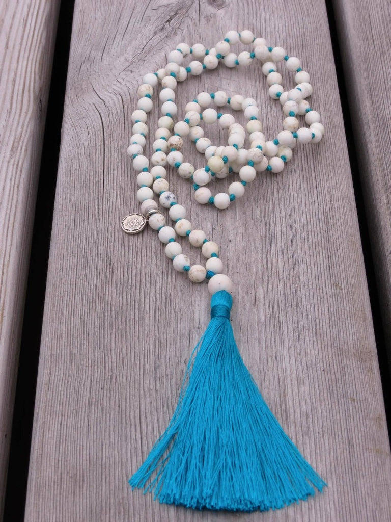 IN THE NOW Mala petite in Howlite, turquoise silk tassel and silver charm Lotus Mandala