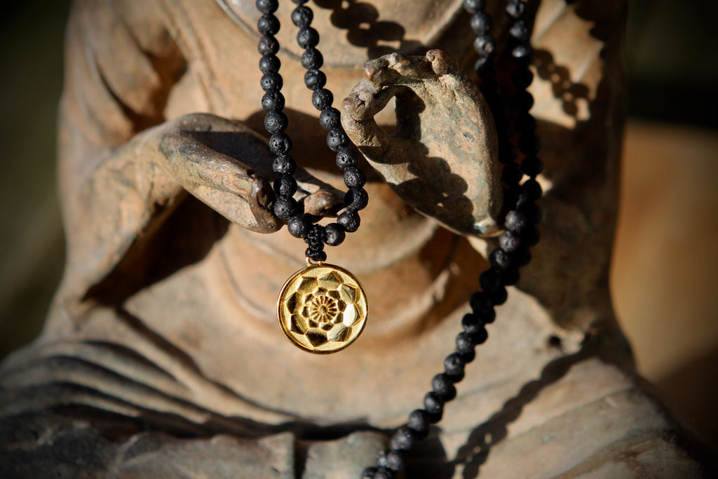 I am Fierce, I am strong Mala in 216 lava beads and goldplated silver charm Lotus