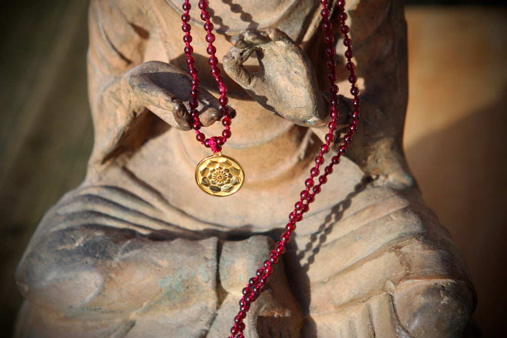 Hear me sing my heartsong mala in 216 garnet beads with goldplated silver Lotus