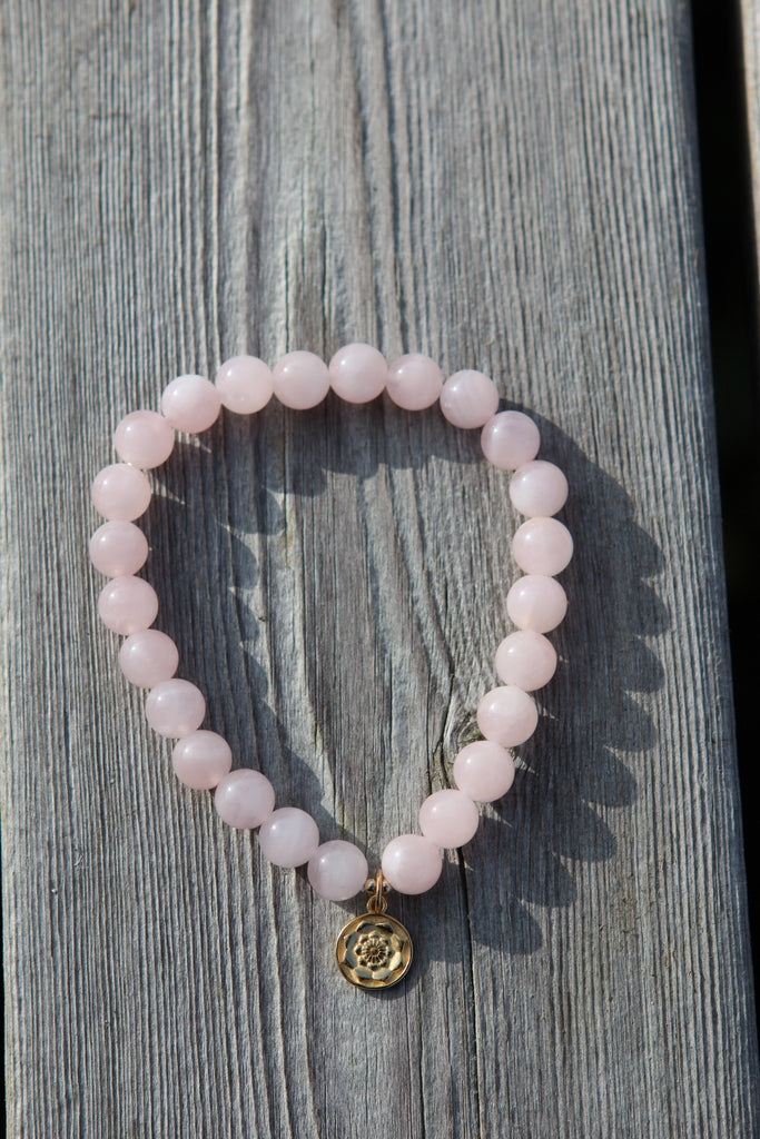 Love bracelet in premium Rose quartz with gold plated silver lotus flower from Amandas Malas