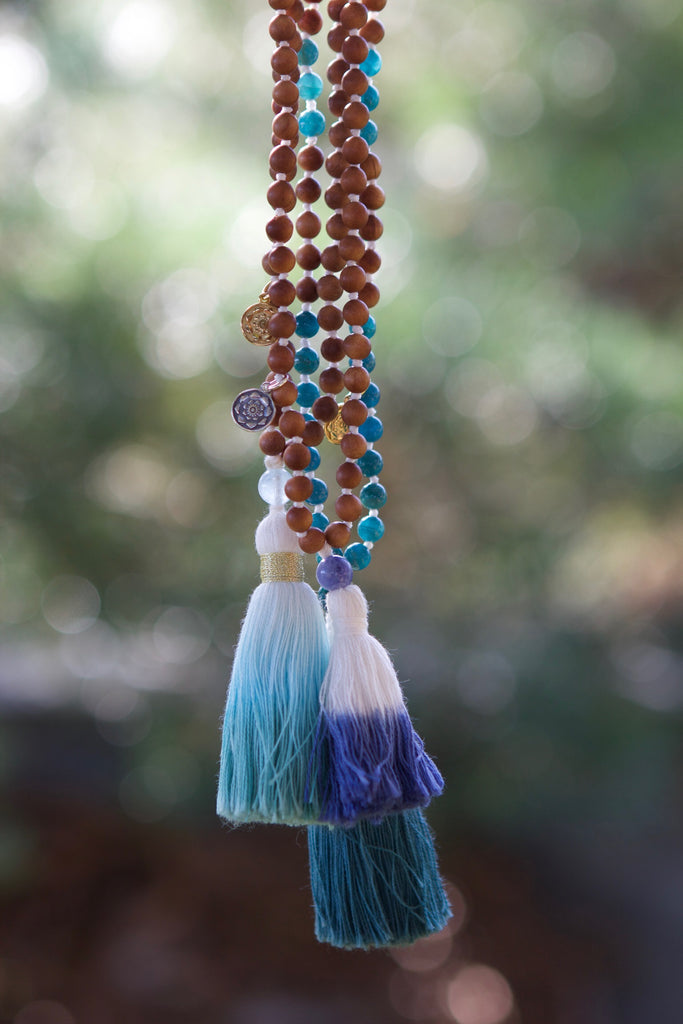 Truth mala in sandalwood & Aquamarine with cotton tassel and gold plated charm Lotus mandala