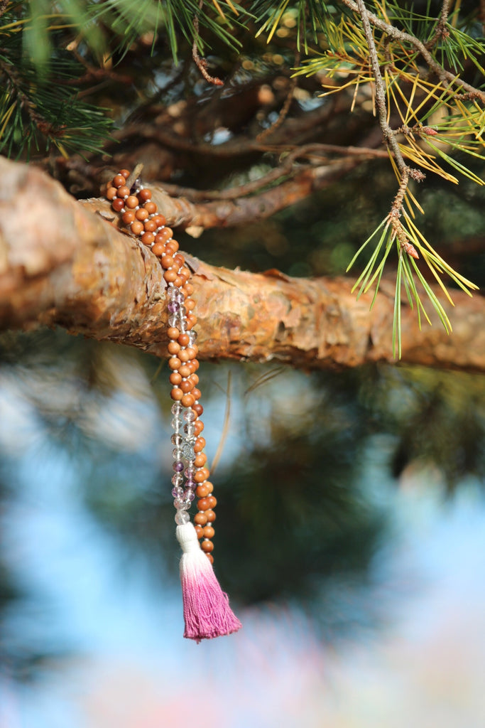 Sacred healing mala in Super seven crystal mala with sandalwood, Quartz gurubead and cotton tassel and silver charm Lotusflower
