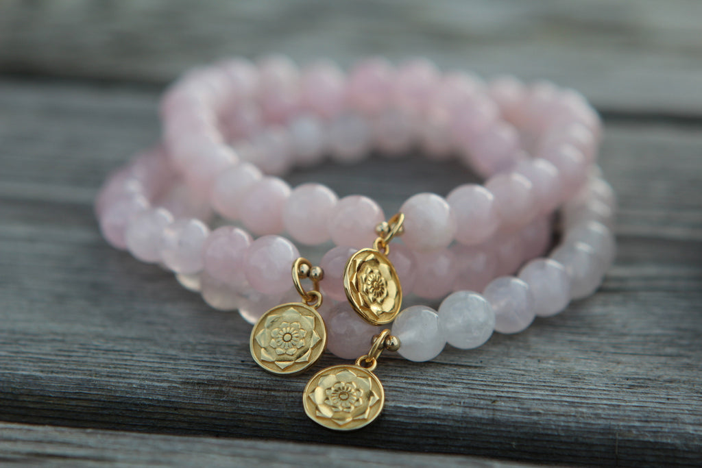 Love bracelet in premium Rose quartz with gold plated silver lotus flower