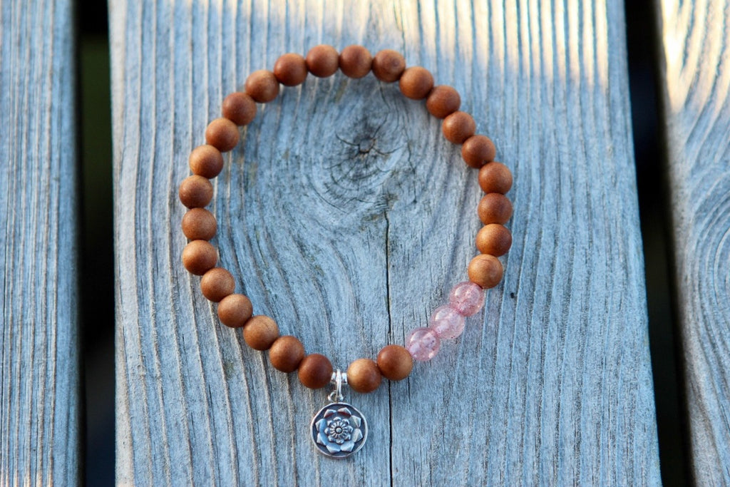 Bracelet in Sandalwood & strawberry rose quartz with silver charm Lotus flower