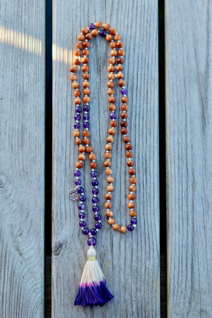 I am the Universe mala in Sandalwood and Amethyst with cotton tassel