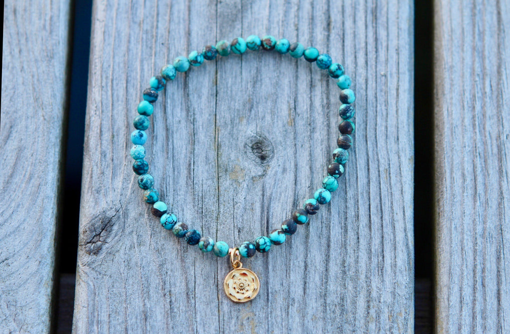 Bracelet Mala in genuine Turquoise with gold plated silver Lotus flower charm