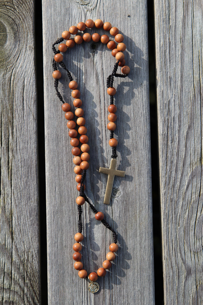 Rosary beads in premium Sandalwood with brass crucifix and goldplated silver charm Lotusmandala
