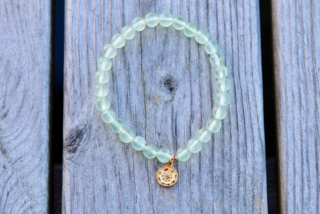 Bracelet in premium Prehnite with a gold plated silver charm Lotus mandala/flower