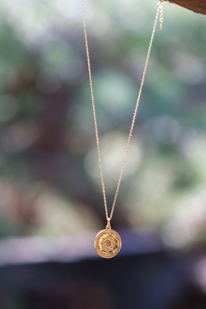 I am necklace. A Lotus flower in Beautiful gold plated silver