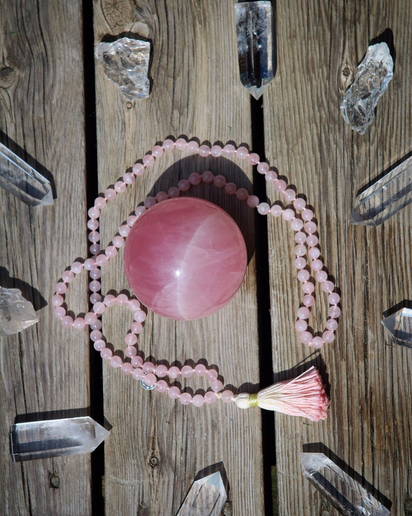 In the light of Love mala in Rose Quartz with cotton tassel and silver charm Lotus flower