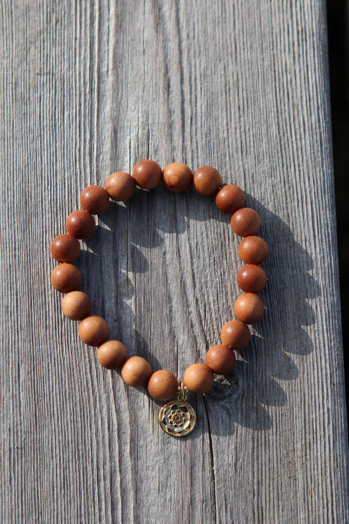 Wisdom bracelet in beautiful Sandalwood with goldplated silver charm Lotusflower