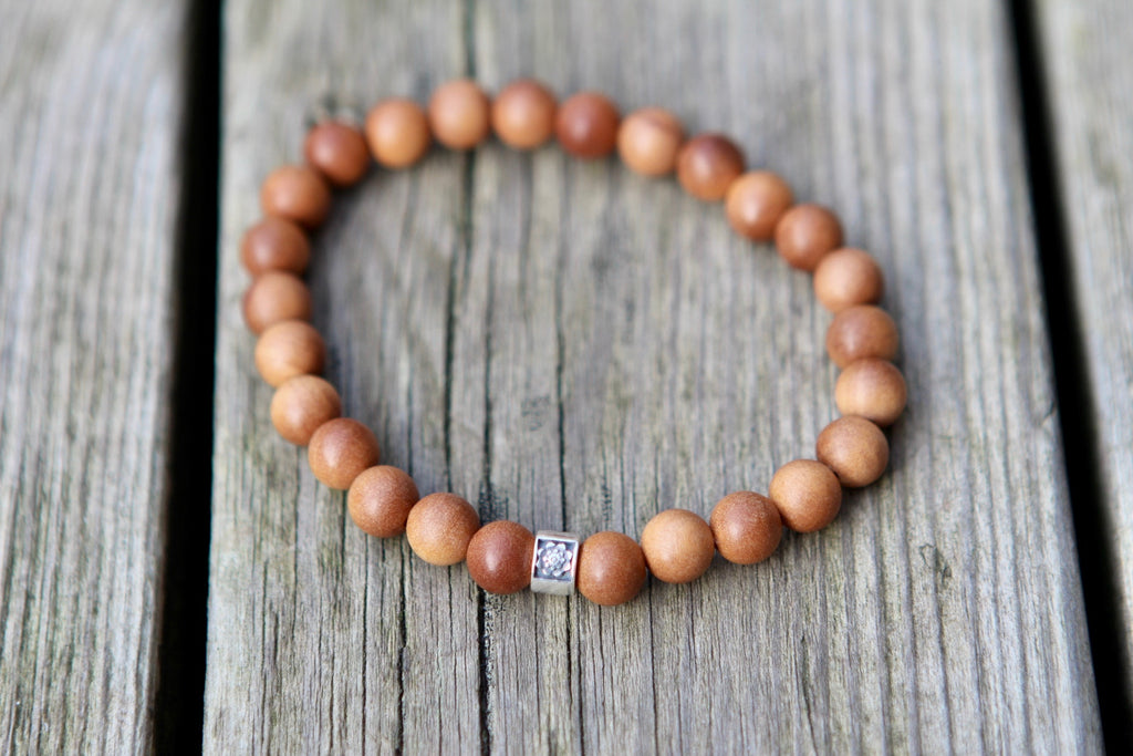 Wisdom stretchy Men's bracelet in Sandalwood with silver bead Lotus flower