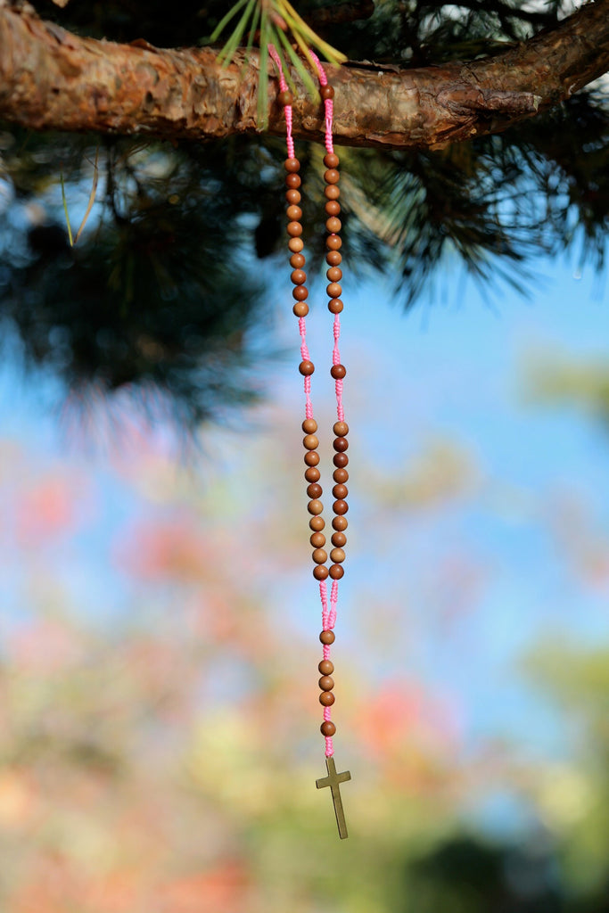 Rosary beads in premium sandalwood with crucifix in brass and goldplated silver charm Lotusflower
