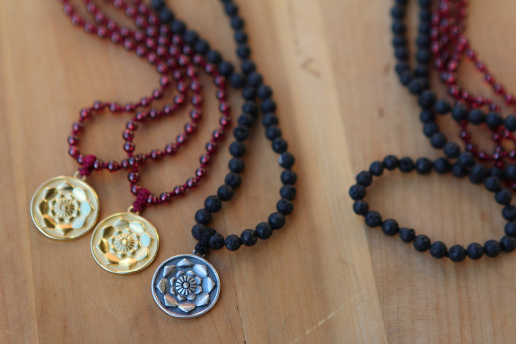Hear me sing my heartsong mala in 216 garnet beads with goldplated silver Lotus Flower