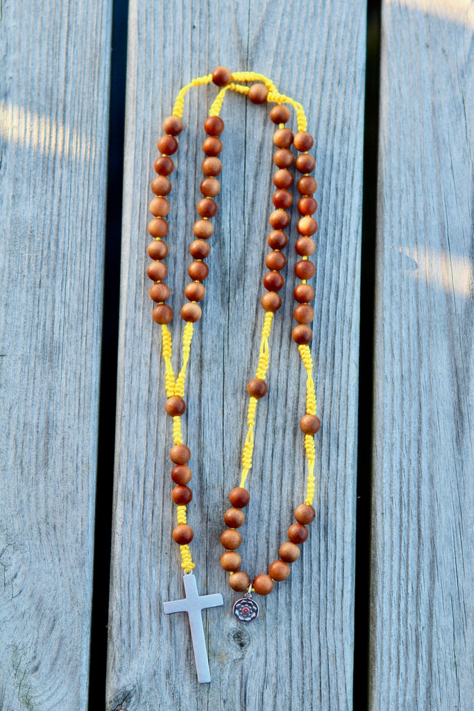 Rosary beads in premium sandalwood with crucifix in silver and a silver charm Lotusflower