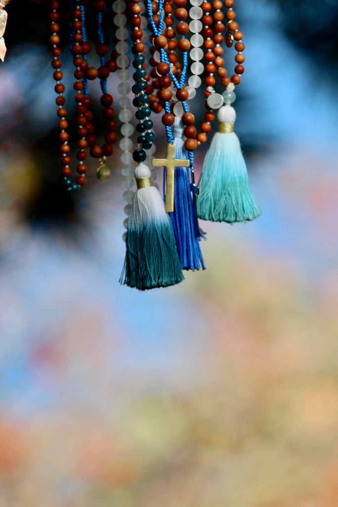 Truth mala in sandalwood & Aquamarine with cotton tassel and gold plated charm Lotus flower