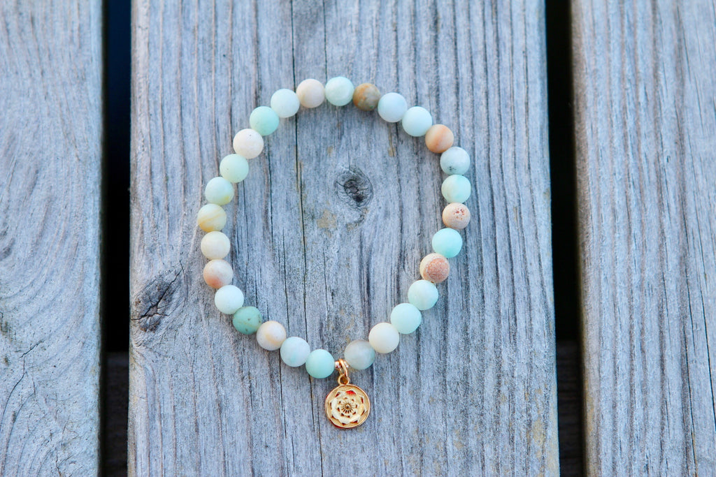 Bracelet in Beautiful Amazonite beads with goldplated silvercharm Lotus Mandala