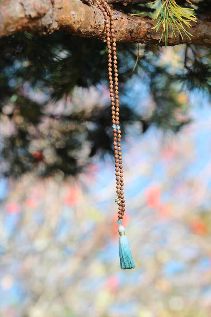 Truth mala in sandalwood & Aquamarine with cotton tassel and gold plated charm Lotus mandala/Lotus flower