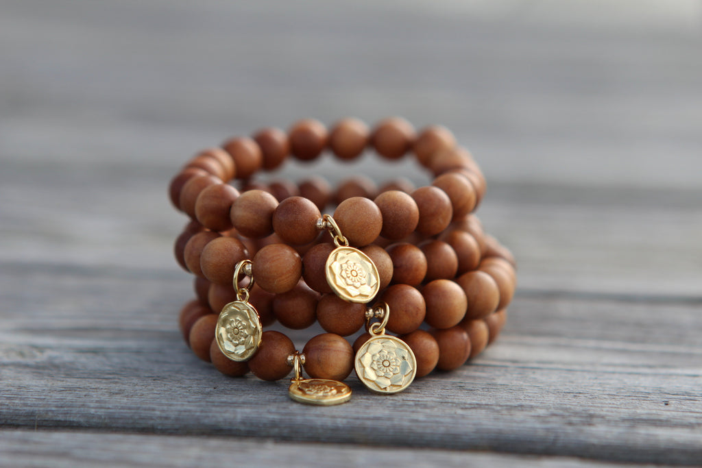 Wisdom bracelet in beautiful Sandalwood with goldplated silvercharm Lotusflower