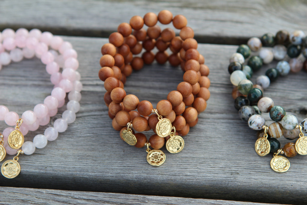 Wisdom bracelet in beautiful Sandalwood with gold plated silvercharm Lotus flower