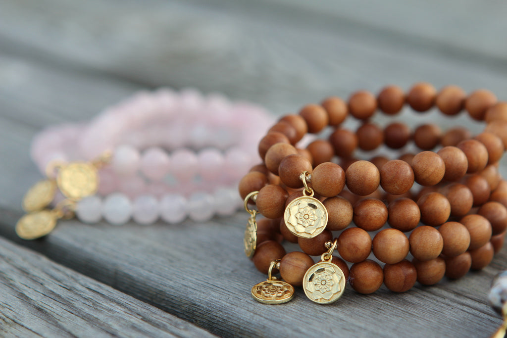 Wisdom bracelet in beautiful Sandalwood with goldplated silvercharm Lotus flower