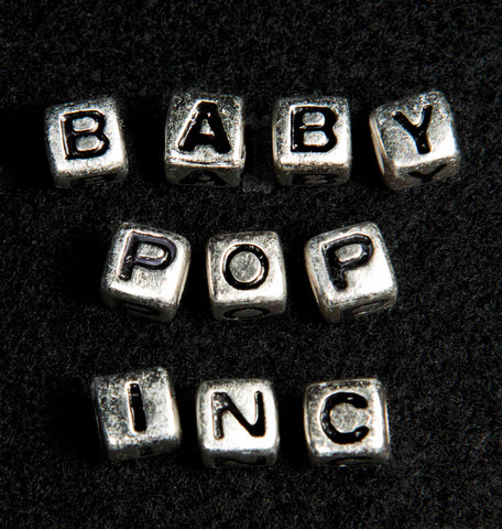 ärtskül Baby Pop, Inc. collaboration. The official fine art series logo. The series is the inspiration for the debut luxury scarf collection by ärtskül.