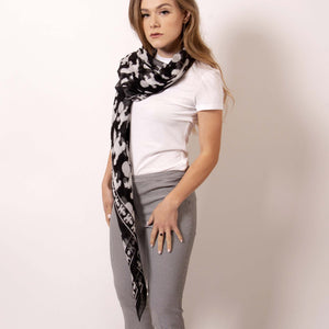Make a statement and transform our chic black and white Baby Pop Square Scarf in silk georgette into a sheer bespoke top. Express your personality and style with a few creative and clever ties. Artskul's first collection is a a contemporary reinterpretation of the distinctive houndstooth black and white motif and adds a nice touch of attitude to any outfit.