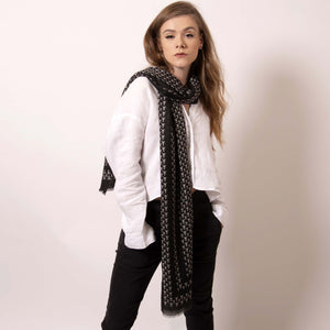 Luxuriously soft, ärtskül's Baby Pop, Nana Rectangle scarf is the must have classic black and white printed cashmere blend scarf. The large rectangle drapes beautifully to create a playful and polished statement that's effortlessly cool and can carry you through any occasion. Lightweight and warming, its perfect for today's wardrobe that works around the clock.