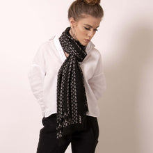 Load image into Gallery viewer, Finish your look with ärtskül's luxuriously soft Baby Pop, Nana Rectangle scarf. This black and white cashmere blend scarf is artfully manufactured by master Italian craftsman and designed in Los Angeles. Lightweight and warming, the scarf features our contemporary reinterpretation of the distinctive houndstooth motif.  The striking geometric repetition of the baby icon produces a chic re-imagining of the centuries old Scottish mosaic.