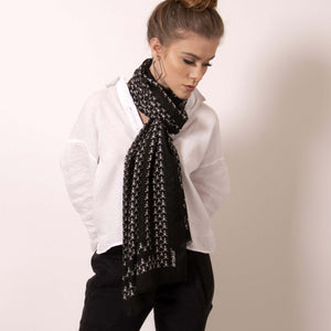 Finish your look with ärtskül's luxuriously soft Baby Pop, Nana Rectangle scarf. This black and white cashmere blend scarf is artfully manufactured by master Italian craftsman and designed in Los Angeles. Lightweight and warming, the scarf features our contemporary reinterpretation of the distinctive houndstooth motif.  The striking geometric repetition of the baby icon produces a chic re-imagining of the centuries old Scottish mosaic.