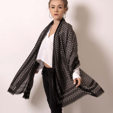 Load image into Gallery viewer,   Swing between delicate and fierce with ärtskül's Baby Pop, Nana Rectangle scarf. This luxurious cashmere blend scarf in black and white is lightweight yet warming.  The scarf drapes beautifully with billowy elegance featuring our contemporary reinterpretation of the distinctive houndstooth motif.  The striking geometric repetition of the baby icon produces a chic re-imagining of the centuries old Scottish mosaic.
