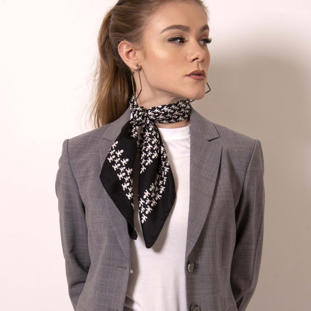 Artskul's Baby Pop Nana Scarf in silk twill is irresistibly chic in  black and white. Shift your image from frivolous fashionista to polished professional with a creative edge. The scarf features the remixed houndstooth pattern with the baby icon and adds a signature look to a crisp white fitted shirt.