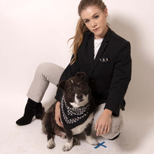 Load image into Gallery viewer, Make a statement with ärtskül's Baby Pop Pocket Square. The design delights and surprises as the contemporary reinterpretation of the distinctive houndstooth black and white motif adds a nice touch of attitude to any suit. Chunks, our ärtskül dog, is pictured wearing the Baby Pop Nana Scarf in Silk Twill.