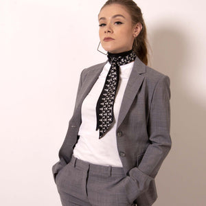 Style ärtskül's edgy Baby Pop Ribbon Scarf as a neck tie with your favorite boss babe suit.  ärtskül scarves are statement pieces, adding edgy sophistication to any style that it's paired with - from streetwear to the office and into the evening. Live Artfully.