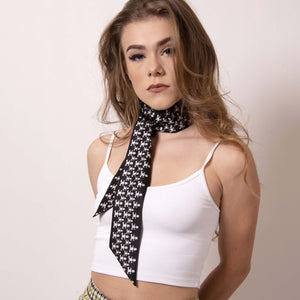 Add edgy flair to your style with our Baby Pop Ribbon Scarf.  Artskul first collection is a a contemporary reinterpretation of the distinctive houndstooth black and white motif and adds a nice touch of attitude to any outfit