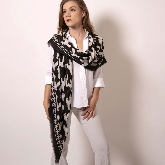 With a simple drape of this cashmere blend scarf, it's what a goddess truly looks like. Wrap yourself in luxury with this Artskul Baby Pop Square scarf featuring our reimagined houndstooth pattern with the baby icon from the fine art series Baby Pop, Inc. Artskul's remixed pattern in black and white is a chic reimagining of the centuries old Scottish Mosaic.  Soft, lightweight and warming - you won't want to be without it.