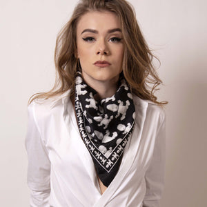 Shift your image from frivolous fashionista to polished professional with a creative edge. ärtskül's Baby Pop Medium Scarf is a statement piece and adds a signature look to a crisp white fitted shirt. When you're off the clock, easily create a new draping effect for the evening.
